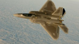 An F-22 flies over the Atlantic during basic combat training. USAF photo.