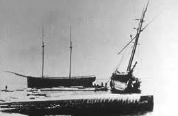 The J.E. Gilmore (left), the A.P. Nichols (right), and the remains of the Forest ashore on Pilot Island, October 1892.