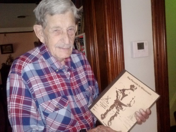Lester Rentmeester holding The Flemish in Wisconsin book.