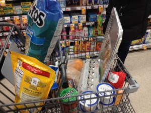 UConn senior Elyssa Eisenberg filled her cart with goodies like chips, salsa and cookie dough. She said although they weren't items typically on her grocery list, the snow day warranted special treats.