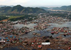 Aerial view of flooded village with debris strewn throughout ...