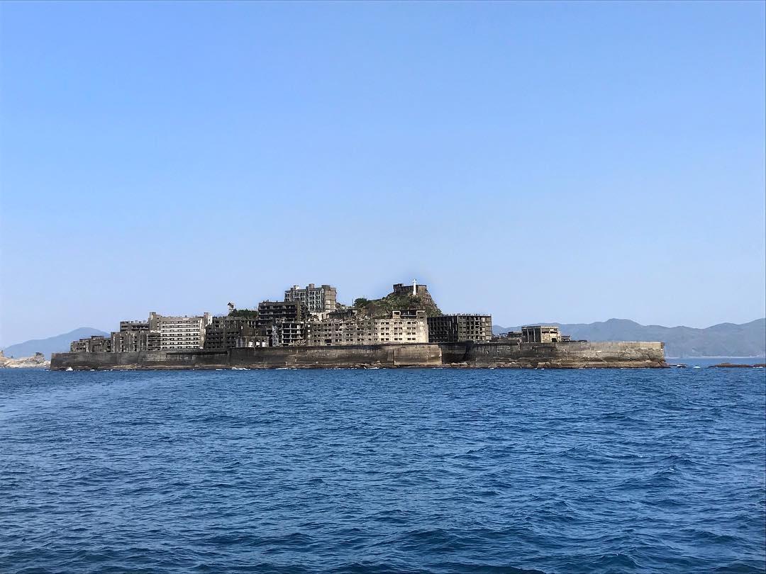 Gunkanjima Island, also called Battleship Island. Known in Japanese as Hashima Island.  It used to be a seabed coal mine since 1810, fully industrialized in 1890, and finally shut down in 1974 and the mine was closed. It was opened for tourism since 2009, and quickly became one of the must-visit in Nagasaki.  Well, Google the rest.  #Nagasaki #GunkanjimaIsland #HashimaIsland #BattleshipIsland #SushinaimiTrip