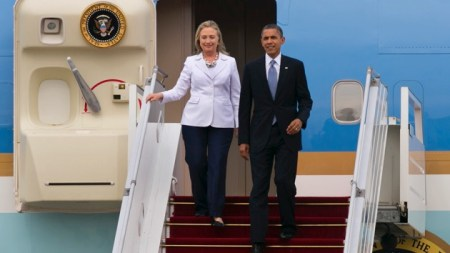 YANGON, MYANMAR - NOVEMBER 19: US President Barack Obama and Secretary of State Hillary Clinton arrive at Yangon International airport during his historical first visit to the country on November 19, 2012 in Yangon, Myanmar. Obama is the first US President to visit Myanmar while on a four-day tour of Southeast Asia that also includes Thailand and Cambodia. (Photo by Paula Bronstein/Getty Images)
