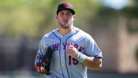 Tim Tebow offered prayers and comfort to a fan having a seizure at an Arizona Fall League Game.