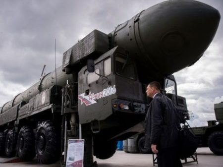 A man looks at a Russian Topol intercontinental ballistic missile launcher at the permanent exhibition of military equipment and vehicles at Patriot Park in Kubinka, outside Moscow, Sept. 8, 2016. (Utkin/AFP/Getty Images)