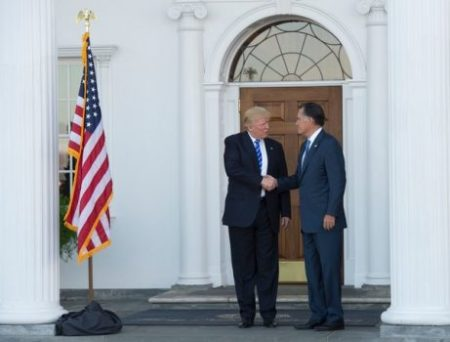 US President-elect Donald Trump shakes hands with Mitt Romney after their meeting at the clubhouse of Trump National Golf Club on November 19, 2016 in Bedminster, New Jersey. / AFP / Don EMMERT (Nov. 18, 2016 – Source: AFP)