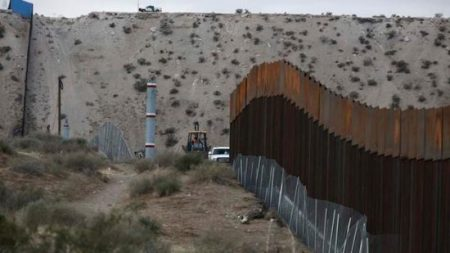 Workers continue work raising a taller fence in the Mexico-US border area separating the towns of Anapra, Mexico and Sunland Park, New Mexico, Thursday, Nov. 10, 2016. (AP Photo/Christian Torres)