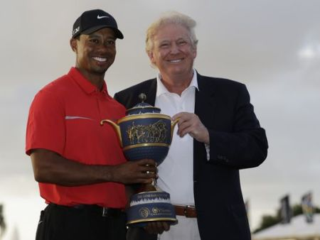 In a file photo from 2013, Tiger Woods stands with Donald Trump as he holds the Gene Serazen Cup for winning the Cadillac Championship in Doral, Fla. (Photo: Wilfredo Lee, AP)