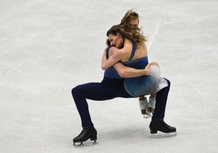 Gabriella Papadakis and Guillaume Czeron of France compete during the free ice dance competition at the European Figure Skating Championship in Ostrava, Czech Republic on January 28, 2017 (AFP Photo/Michal Cizek)