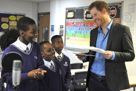 Britain's Prince Harry speaks to pupils at a lyrical writing class during a visit to the Full Effect and Coach Core programmes, two projects supported by The Royal Foundation that work to improve opportunities for young people, at Nottingham Academy, Nottingham, England, Wednesday, Feb. 1, 2017.  (AP Photo/Rui Vieira, Pool)