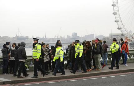 Police officers patrol on Westminster Bridge in London, Friday March 24, 2017. On Thursday authorities identified a 52-year-old Briton as the man who mowed down pedestrians and stabbed a policeman to death outside Parliament in London, saying he had a long criminal record and once was investigated for extremism — but was not currently on a terrorism watch list. (AP Photo/Matt Dunham)