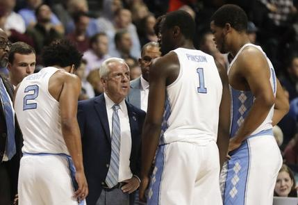 North Carolina head coach Roy Williams talks to players during a timeout in the second half of an NCAA college basketball game against the Duke during the semifinals of the Atlantic Coast Conference tournament, Friday, March 10, 2017, in New York. Duke won 93-83.(AP Photo/Julie Jacobson)