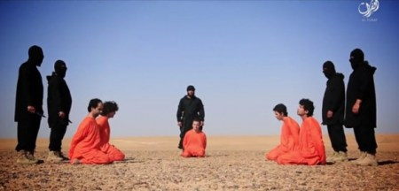 (Screengrab: Heavy.com)Islamic State militants stand behind accused spies in a publicized beheading video that was filmed in the Syrian desert and posted to pro-IS media outlets on June 28, 2016.