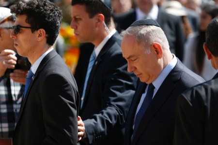 Israeli Prime Minister Benjamin Netanyahu (R) attends a ceremony marking the annual Holocaust Remembrance Day at the Yad Vashem Holocaust Memorial in Jerusalem on April 24, 2017.  Israelis stood silent and sirens rang out for two minutes as the country held its annual remembrance of the six million Jewish victims of the Holocaust. / AFP PHOTO / POOL / AMIR COHENAMIR COHEN/AFP/Getty Images