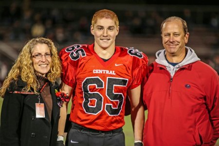 Timothy Piazza with his parents Evelyn and James Piazza at a high school football game in Flemington, N.J., in 2014. (Patrick Carns, via Associated Press