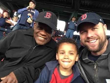 From right, Calvin Hennick, his 6-year-old son, Nile, and Hennick's father in law, Guy Mont-Louis. They attended Tuesday night's game at Fenway Park. (Boston Globe)