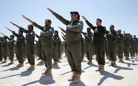 Graduates of a U.S.-trained Syrian police force, which expects to be deployed in Raqqa, salute during a graduation ceremony Saturday near Ain Issa village, north of the de facto Islamic State capital in Syria. (Goran Tomasevic/Reuters)