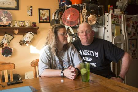 In this Friday, July 7, 2017, photo, Tammie Jackson, and her husband, Travis Jackson of Butte, Mont., discuss their Medicaid program benefits at their home in Helena, Mont. Tammie, who was uninsured until she enrolled in Montana's expanded Medicaid program, receives medical care for a host of health issues, including a back injury that has kept from returning to her job cleaning hotel rooms. Montana officials who tout the dramatic drop in the state's medically uninsured due to expanded Medicaid, are now under pressure to reduce the number of new Medicaid enrollees. (AP Photo/Bobby Caina Calvan)