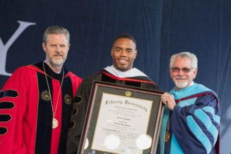 (PHOTO: LIBERTY UNIVERSITY/MITCHELL BRYANT) Rashad Jennings (center) at Liberty University's Commencement Ceremony on Saturday, May 14, 2016, in Lynchburg, Virginia.