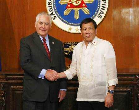 Rex Tillerson, left, Rodrigo Duterte on Monday. Bullit Marquez / AP