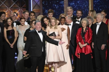 """(PHOTO: REUTERS/MARIO ANZUONI) Bruce Miller with the cast and crew accept the award for Outstanding Drama Series to """"The Handmaid's Tale"""" at the 69th Primetime Emmy Awards show in Los Angeles, California on September 17, 2017."""
