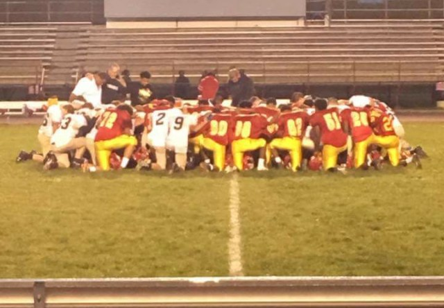 Bridgeport High School junior varsity football players pray with coaches and opponents in this photo posted to Facebook on September 7, 2017. (PHOTO: FACEBOOK/ASHLEY LYNN MILLER)