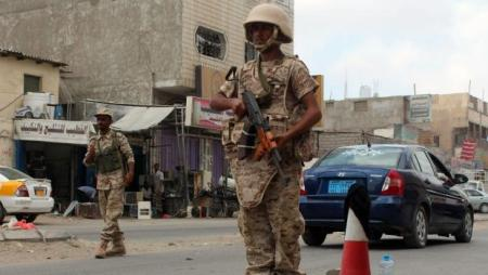Loyalist forces stand guard on a main road in the Mansoura residential district of Yemen's second city of Aden after they pushed Al-Qaeda out of parts of the southern city on March 30, 2016 in a new drive against the jihadists, military sources said. Troops and militia retook the central prison and deployed on main roads across the Mansura district after a three-hour gunbattle with the jihadists, the sources said. / AFP / SALEH AL-OBEIDI (Photo credit should read SALEH AL-OBEIDI/AFP/Getty Images)