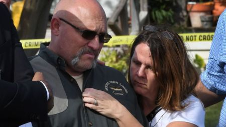 Pastor Frank Pomeroy and his wife Sherri speak during a press conference at the entrance to the First Baptist Church, after a mass shooting that killed 26 people in Sutherland Springs, Texas on November 6, 2017. A gunman wearing all black armed with an assault rifle opened fire on a small-town Texas church during Sunday morning services, killing 26 people and wounding 20 more in the last mass shooting to shock the United States. / AFP PHOTO / Mark RALSTON (Photo credit should read MARK RALSTON/AFP/Getty Images)