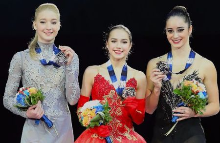 From Left to Right: Maria Sotskova (RUS), Alina Zagitova (RUS), and Kaetlyn Osmond (CAN)  Photo © Robin Ritoss