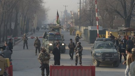 Afghan security personnel block a road near the site of a suicide attack in Kabul on Monday. A suicide attacker on foot blew himself up near a compound belonging to the Afghan intelligence agency in Kabul on December 25, killing six civilians, officials said. Shah Marai/AFP/Getty Images