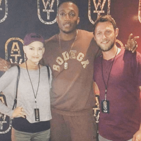 Lecrae poses with fans Hayden and Adam Palm after a concert, November 2017.(SCREEN SHOT: FACEBOOK)