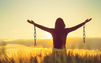 382bea19-4280-4ab1-8292-2827bd1b58b8-woman-freedom-chains-iStock