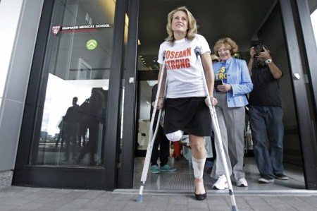 Roseann Sdoia leaves Spaulding Rehabilitation Hospital in Boston in May 2013 after losing part of her right leg in the explosions near the finish line of the Boston Marathon. Charles Krupa/AP