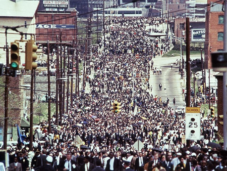 The funeral procession of the Rev. Martin Luther King Jr. arrives at Ebenezer Baptist Church in Atlanta on April 9, 1968. (AP Photo/Charles Tasnadi)