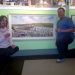 Sandy &amp; Rog next to her Grandfathers painting