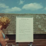 The Surf Club Hut at Compton with John Ainsworth reading the National Trust notice board
