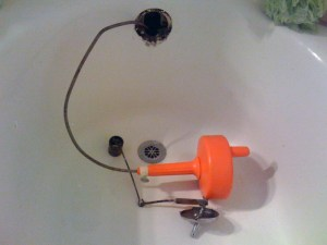 When snaking a tub use the overflow plate