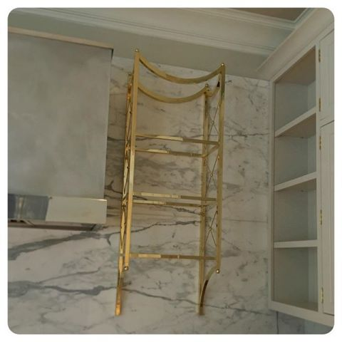 custom brass shelf just installed in lake forest