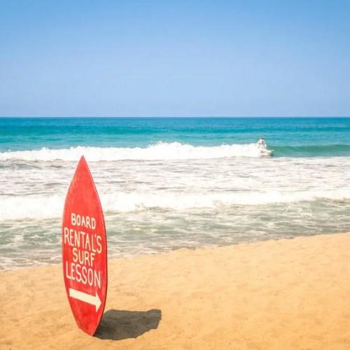 32848472 - surfboard at exclusive beach - surfing school destinations worldwide