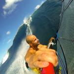 Charles Vandemeulebroucke riding waves in Tahiti