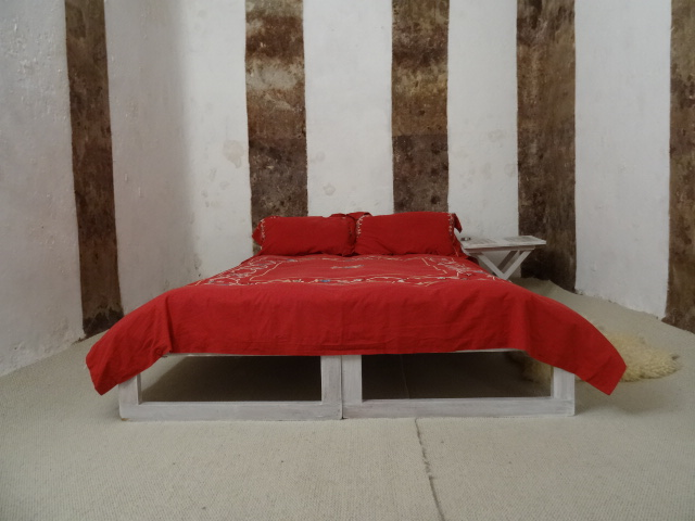 Bedroom inside the converted concrete tank.
