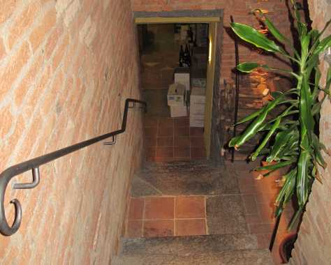 Stairs to one of the most intriguing restaurant wine cellars in Roero.
