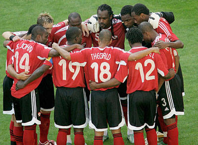 """Photo: The """"Soca Warriors"""" received national Chaconia silver medals for qualifying for the 2006 World Cup."""