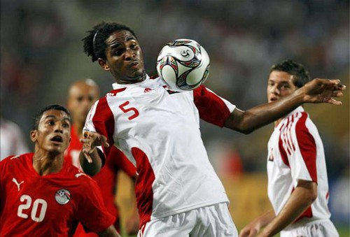 "Photo: ""Soca Warrior"" Akeem Adams controls the ball during a 2009 Under-20 World Cup match against host nation Egypt. (Courtesy CONCACAF)"