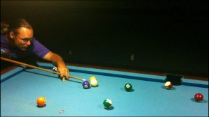 Mike shooting pool