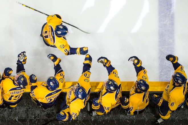 Nashville Predators center Filip Forsberg (9) is congratulated by teammates after scoring a goal against the Colorado Avalanche during an NHL game at Bridgestone Arena in Nashville, Tennessee, on Tuesday, April 5, 2016. The Predators beat the Avalanche 4-3, disqualifying Colorado from the playoffs. Nick Wagner/CSM Images