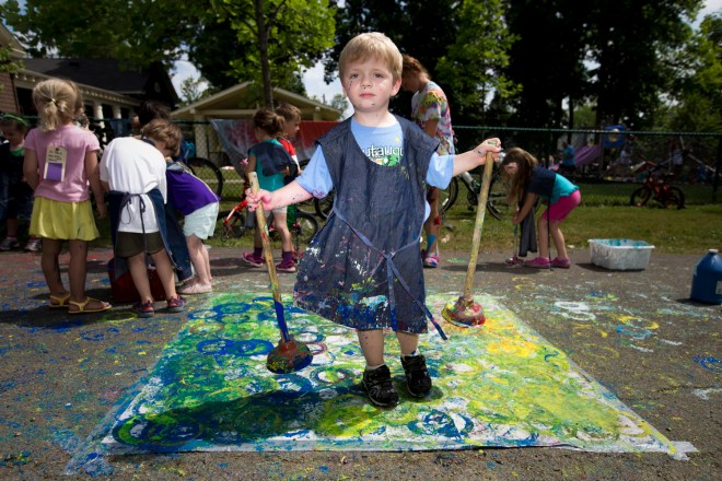 Russell Gardner, 5, holds plungers he used as paintbrushes during the Big Art Everywhere activities Wednesday, July 6, 2016, at the Children's School.