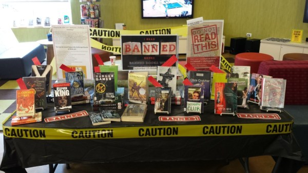 Check out the display of books that have been challenged in other libraries! Ours are all available for you to check out and read to see what the fuss is about.