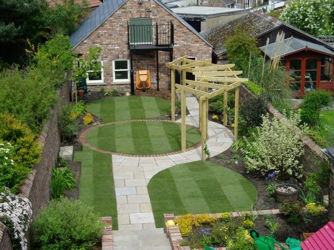 Circular lawn encased by oak sleepers designed by Bushy Business