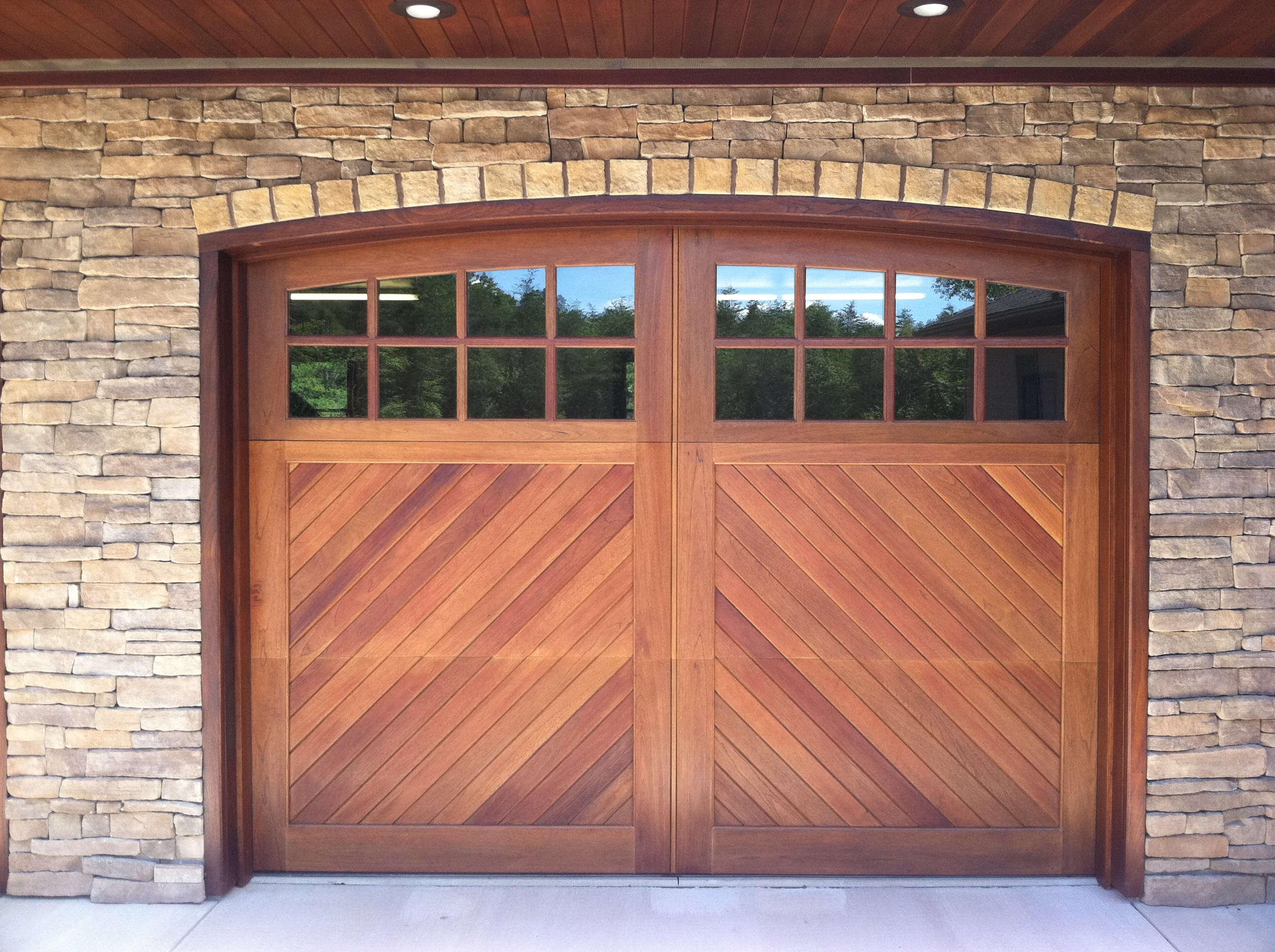 Garage And Front Doors That Match Wood Garage Doors And Carriage Doors Clearville Pennsylvania